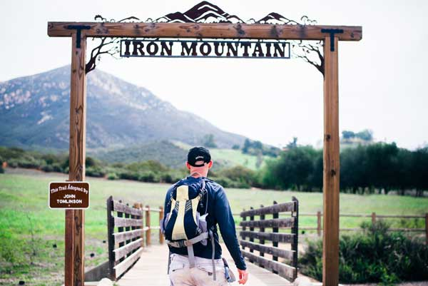 Mand Under Iron Mountain Sign