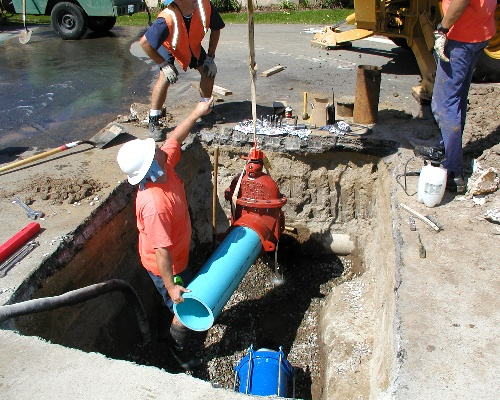 Certified employee working on water main.