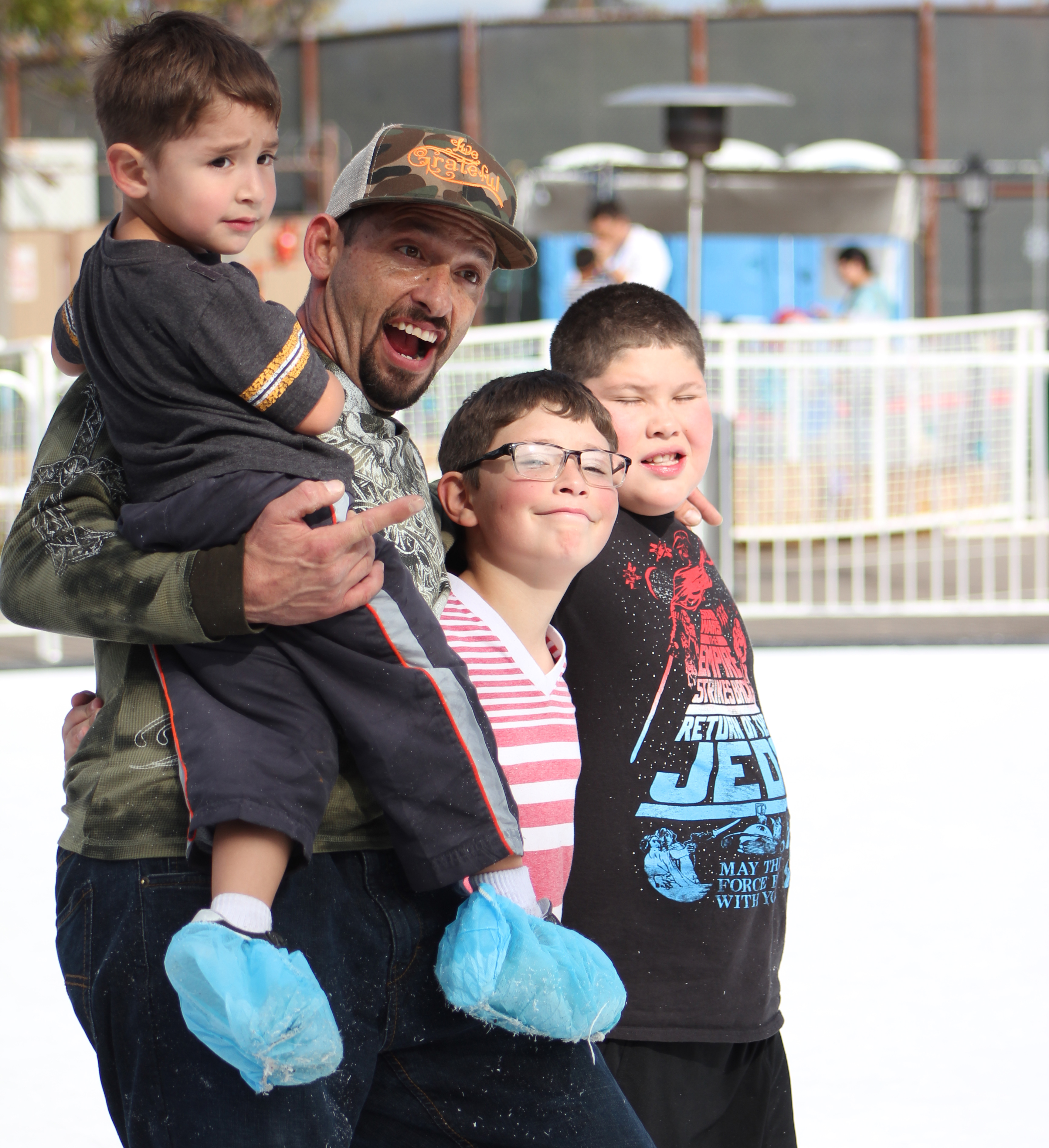 Father and Sons on Ice Rink Skating Poway Community Park Winter Festival Special Needs